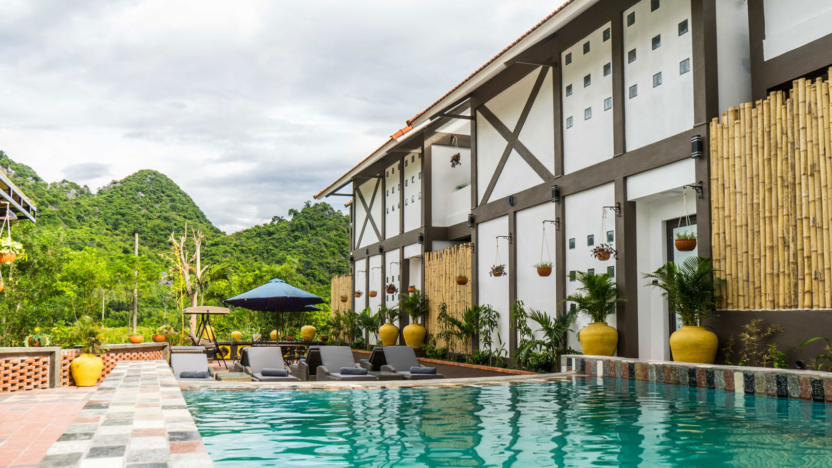 Victory Road Villas in Phong Nha, Vietnam: luxurious accommodation, with a swimming pool, sauna, full bar, tasty Western food and top-quality tours, activities, and entertainment.
